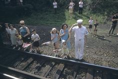 RFK Funeral Train RFK was killed on June 4, 1968; four days later, after his body had been flown to New York, a funeral train carried him from NYC to Washington. Paul Fusco hopped on the train and shot color photographs the whole way down