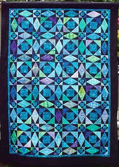Stormy Night at Sea, quilt by Terry L. Crean. Purple, turquoise and green batiks set in black. Quilted with TLC