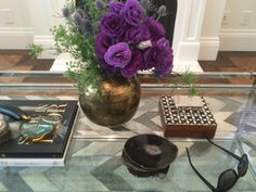 Agate coasters, stack of books with magnifying glass, beautiful Lisanthius flowers and inlay box