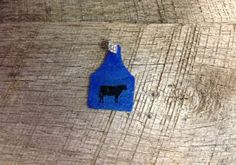 Blue ear tag pendant with blue sparkles and black cow silhouette. Comes with rhinestone pinch bail. Repin to be entered to win one of four $50 gift certificates during our Five Year Anniversary Celebration in July 2014.