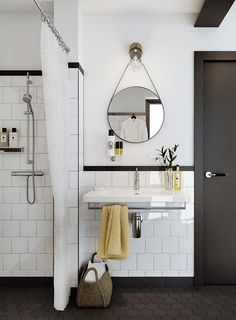 Black hexagon tile, white wall tile w/dark grout. We like the black door and molding too.