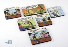Imanes de nevera hechos a mano reciclando viñetas de viejos cómics.