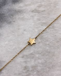 Dainty Star Bracelet in gold-plated sterling silver.