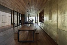 The kitchen cupboards in a golden wall