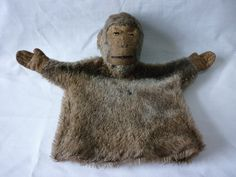 Antique plush hand puppet in the form of a monkey with a label entitled Griff