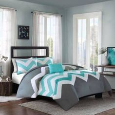 Add a pop of color to your bed with the eye-catching Cade Reversible Comforter Set. Decked out in an aqua and grey chevron design and solid grey reverse, the bold bedding is a fun and funky addition to any bedroom. Aqua Bedrooms, Gray Bedroom, Bedroom Sets, Master Bedroom, Bedroom Decor, Girl Bedrooms, Modern Bedroom, Queen Comforter Sets, Bedding Sets
