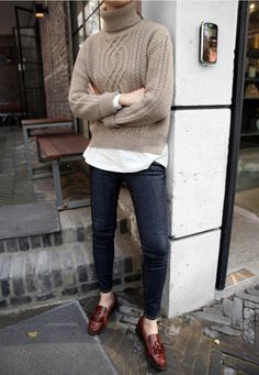 Oatmeal colored sweater with dark rinse jeans and loafers.