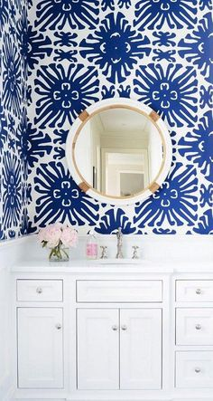 China Seas Sigourney wallpaper-- white cabinetry and counter tops, with pops of pastel pink and brass against the stunning geometric floral tribal cobalt blue and white wallpaper. Wow such inspirational bathroom interior design!