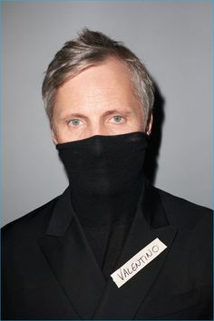 Viggo Mortensen poses for a cheeky photo in Valentino for GQ France.