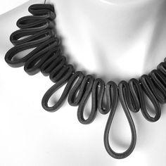 Items similar to black rubber necklace, modern geometric design, avant garde statement piece on Etsy