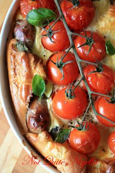 Toad In the Hole ( can use any kind of sausage)  An Original Recipe by Not Quite Nigella    1 tablespoon oil  500g Italian sausages, pricked lightly with 1 hole  250g vine ripened cherry tomatoes on the vine  fresh basil leaves  For Batter    120grams flour  285ml cold milk  3 eggs  pinch of salt  50ml icy cold soda water
