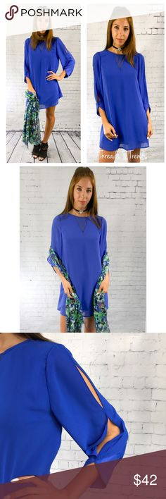 Mia Shift Dress The Mia gorgeous royal blue shift dress with cut out sleeves. Very nice quality fully lined. Made of chiffon/poly blend. Keyhole button closure on back.                 Small  Bust 38 Length 34  Medium  Bust 40 Length 35  Large  Bust 42 Length 36 Threads & Trends Dresses