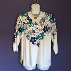 Blue & White Floral Blouse Spring is here!   The floral print on this blouse is perfect for the season.   Pattern continues to the back.  Material:  60% Cotton/40% Polyester Allison Daley Tops