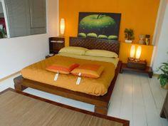15 Magníficos Dormitorios con Paredes en Color Naranja