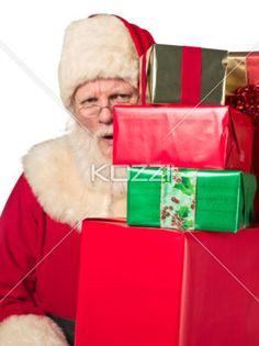 portrait image of santa claus with gift box. - Portrait of Father Santa Claus holding stack gift box. Model: Larry Lantz