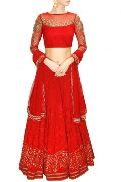 Astha Narang a red net blouse with sequins and dabka embroidery.  It comes along with matching crepe lehenga with thread and sequins embroidery.  It is paired with sequin embellished red net dupatta.