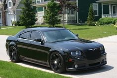 Chrysler 300 blacked out, dear Mitchel, this will be what ours looks like!!<3
