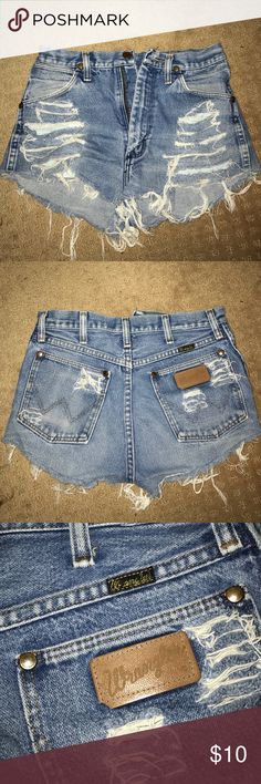 Distressed denim shorts. Light blue, shows a little bit of booty. Wrangler Shorts Jean Shorts