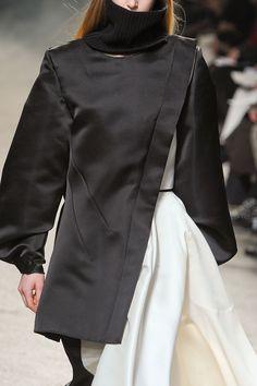 Sleek black asymmetrical jacket; fashion details // Aganovich Fall 2012
