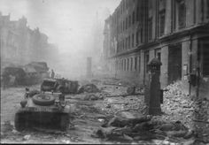 """Battle of Berlin, May 1-2,1945: 11.SS Division """"Nordland"""" KIAs lie at the corner of Friedrichstrasse and Raynhardshtrasse after an unsuccessful attempt to break the Russian encirclement on the night of May 1-2. The street is replete with wrecked staff cars and armored vehicles.The photo was shot 170 meters from the closest bridge, which was one of the few points where a breakthrough could have been achieved."""
