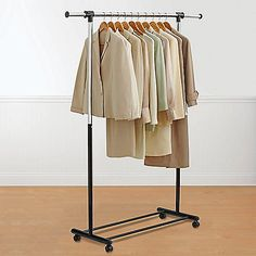 Expandable Black And Chrome Garment Rack Fits Perfectly In Any Space.  Height Adjusts From 38