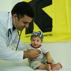 Photo: Syrian refugee baby gets a checkup at an IRC clinic in Jordan | International Rescue Committee (IRC)