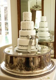 A 4 tier wedding cake trimmed with satin ribbon and edible lace. 4 Tier Wedding Cake, Square Wedding Cakes, Wedding Cake Stands, Wedding Cakes With Cupcakes, Cupcake Cakes, Cupcake Ideas, Pretty Cakes, Beautiful Cakes, Amazing Cakes