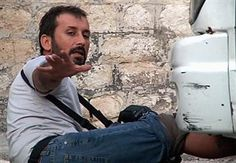 Turkish photojournalist Sinan Gül of the Anatolia news agency was shot in the foot while covering clashes in Syria (August 2013)