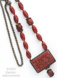 nlor811(e)-Pendant necklace of vintage hand carved cinnabar lacquer beads, antique Chinese silver beads and old cinnabar buckle with silver chain.