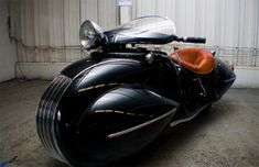 """""""Frank Westfall's 1930 Art Deco Henderson  motorcycle,which was built by O. Ray Courtney in 1936 and is based on a  1930 K.J Henderson. Grail Mortillaro of Knucklebuster spotted the bike at the Rhinebeck Grand National Super Meet. The bike  ispowered byinline four cylinder and with the enclosed wheels and long  wheelbase.It looks abit unwieldy, and tough to ride, but Grail  Mortillaro says he saw Westfall take the bike for a spin around the  fairgrounds. Knucklebuster write..."""