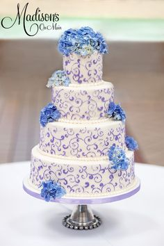 Buttercream with lavendar scrollwork and fresh hydrangeas..... - This bride and groom are the sweetest couple.  He is one of the state senators here in OK, and they are so warm and kind.  They had a church reception in the atrium and chose a buttercream iced cake with lavendar scrollwork.  Fresh hydrangeas crowned the top and accented the side.  Photo by Kevin Paul Photography.