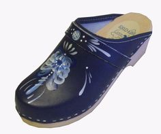 Things I Can't Live Without: A favorite pair of blue Swedish clogs.  Mine also have my name written in lovely script on the sides.