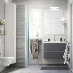 Furniture Thailand Online l IKEA Thailand A light grey small bathroom with a white high cabinet, a mirror and a grey wash-stand with two drawers.A light grey small bathroom with a white high cabinet, a mirror and a grey wash-stand with two drawers. Ikea Bathroom, Small Bathroom Storage, Grey Bathrooms, Bathroom Furniture, Bathroom Interior, Bathroom Ideas, Bathroom Organization, Bathroom Gray, Vanity Bathroom