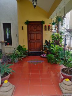 Front door with green plants This pic is part of Jayala Indian Home Design, Indian Home Interior, India Home Decor, Ethnic Home Decor, Moroccan Decor, Diwali Decorations At Home, Home Entrance Decor, Village House Design, Indian Homes