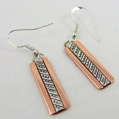 Beautiful, Delicate Earrings in Copper and Silver too! Feathers Copper and Silver Earrings by Navajo artists, Randy Secatero and Sylvana Apache.