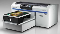 The Epson SureColor F2000 Series printers mark Epson's introduction into the DTG market with two all-new, purpose-built, DTG inkjet printers delivering industrial-level production, image quality, and reliability. This printer is ideal for small-to-medium-sized print shops looking to capitalize on short-run, highly customizable T-shirt printing jobs. From Epson America, proimaging.epson.com.