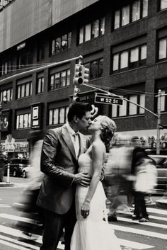 A kiss in New York City as the world goes by!