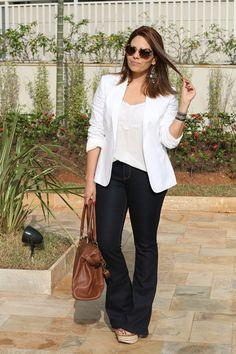 flare jeans; white blazer; beige purse; white blouse