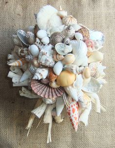 ALL ABOUT HONEYMOONS - Join our Facebook page! https://www.facebook.com/AAHsf Beach Wedding Seashell Bouquet by Jolly Fine Tiaras on Etsy.