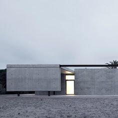 karien anne - architecture - grey concrete building house by Hidalgo Hartmann