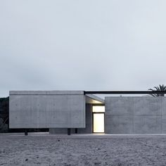 karien anne - architecture - grey concrete building house by Hidalgo Hartmann