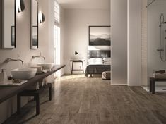 Contemporary bathroom space with adjoining bedroom. Floors from Treverkever tile collection by Marazzi. Wood Effect Tiles, Wood Tiles, Buy Tile, Tiles Online, Tile Design, Deco Design, Bathroom Interior, Design Bathroom, Bathroom Ideas