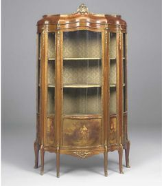 A FRENCH GILT-METAL MOUNTED MAHOGANY AND VERNIS MARTIN STYLE DECORATED SERPENTINE VITRINE LATE 19TH EARLY 20TH CENTURY  The painted panels depicting a courting couple with attendents in a woodland clearing, and enclosing serpentine shelves on foliate mounted cabriole legs with sabot feet.