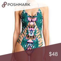 "Maristar Lattice Maillot One-Piece Green Swimsuit BRAND NEW with TAGS!! One-Piece swimsuit in a mix of geometric and leaf prints. Slim bands create peek-a-boo panels in the front and back. Adjustable, crisscross shoulder straps. Lined. 80% nylon/20% elastane.  🌟 Similar style by Mara Hoffman.🌟  Measurements: M: Bust: 34"" /Waist: 27-28""/Hip: 30"" / Length: 25.2"" L: Bust: 36"" /Waist: 28-29"" /Hip: 31.8"" / Length: 25.5""  🌟🌟Item is Brand New, direct from the Manufacturer, & Sealed in Pkg. 🌟🌟…"