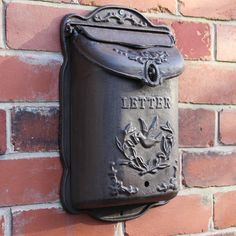 This Cast Iron Wall Mounted Mail Box is excellent wall decor or garden decor for any style home. We love its rustic, vintage inspired design. Perfect for lovers of classic, vintage or retro inspired interiors. Old Mailbox, Vintage Mailbox, Mailbox Ideas, Door Ideas, Wall Mount Mailbox, Mounted Mailbox, House Front Door, Front Door Decor, Front Porch
