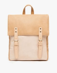 ROCKLAND BACKPACK [Need Supply]   Vintage-inspired faux leather backpack with two-tone minimal styling. Features adjustable shoulder straps, outer side pockets, printed inner lining, top snap closure and foldover flap with magnetic snap closures.