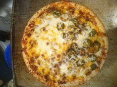 Taco Pizza on LBGE!! Crust covered in evoo, medium salsa and medium taco sauce as the base sauce, thin layer of cheddar, brown hamburger in taco seasoning then drain and put over entire pizza, add another layer of cheddar, add a light layer of monzarella, then pickled jalapeños.  Cook in big green egg until done at around 550. This may have been the best pizza I have ever had.