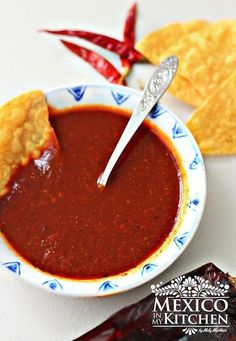 This red taqueria salsa is absolutely delicious on steak or pork carnitas tacos. You need only a few ingredients to make it at home, and it lasts several days in the fridge.  The roasted peppers give a robust flavor to the salsa.  I've been hooked on it since the first time I tried it at my local taqueria, but it can also be used over your breakfast fried eggs or that fried chicken you love for dinner.  If you love spicy #salsas #recipe #mexican #food #homecook #mexicoinmykitchen