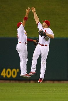 Matt Holliday and Jon Jay celebrate after a 5-2 win over the Chicago Cubs, June 17, 2013.