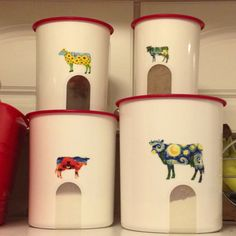 Tupperware canisters w/ cow stickers on them.